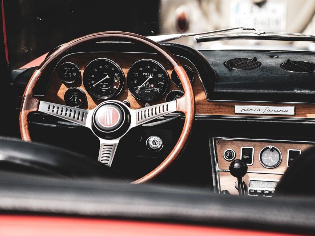Wooden steering wheel in car